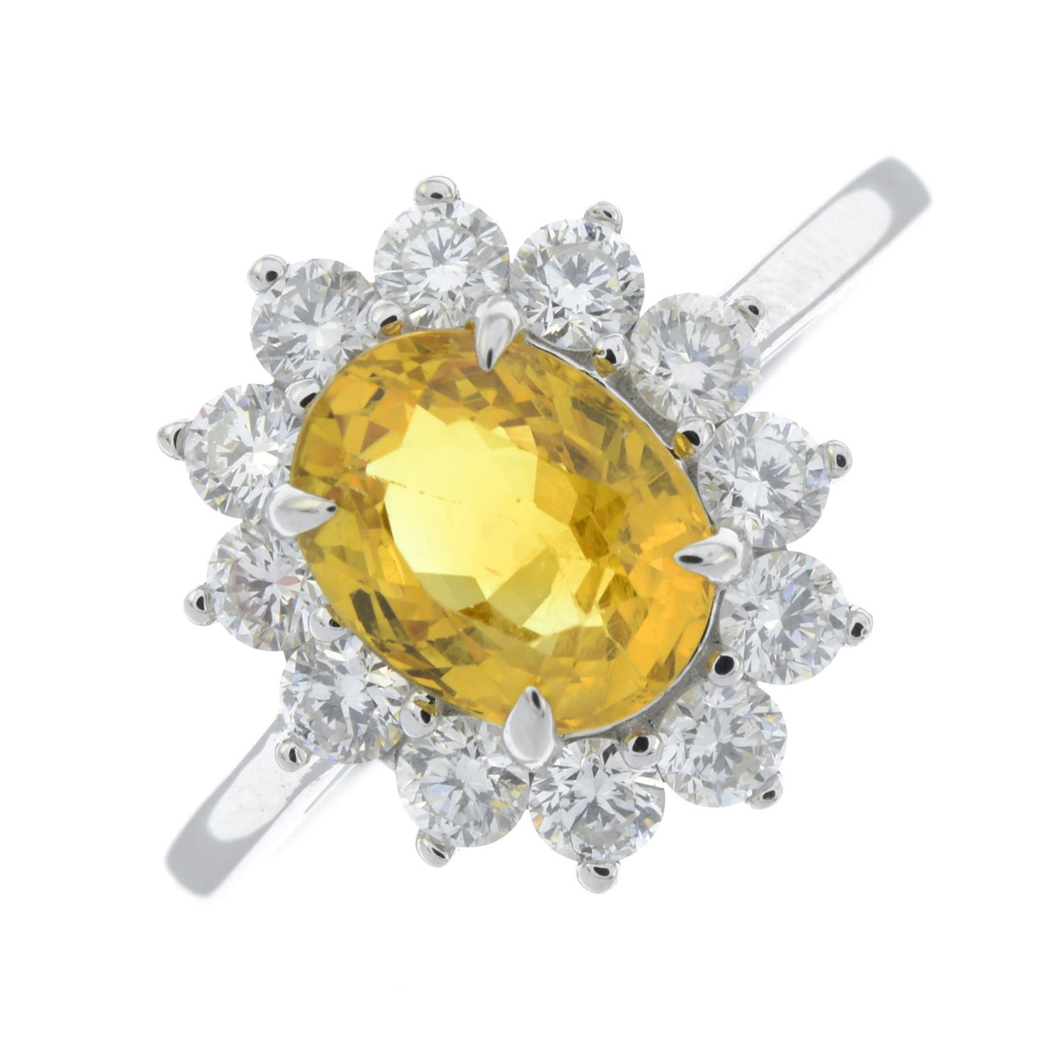 A yellow sapphire and brilliant-cut diamond cluster ring.Sapphire calculated weight 1.73cts, - Image 2 of 6