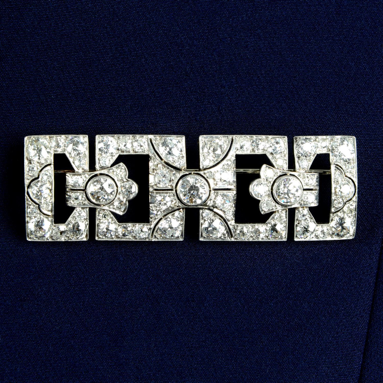 An Art Deco platinum and gold old-cut diamond geometric brooch.