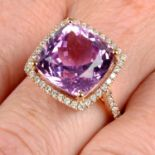 An 18ct gold kunzite and diamond cocktail ring.Kunzite weight 10.02cts.Total diamond weight 0.43ct,