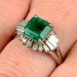 An emerald and vari-cut diamond dress ring.