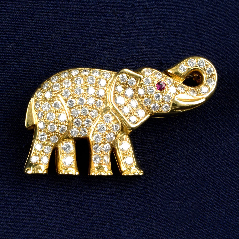 A pavé-set diamond elephant brooch, with ruby eye.Total diamond weight 1.70cts.Length 3.9cms.
