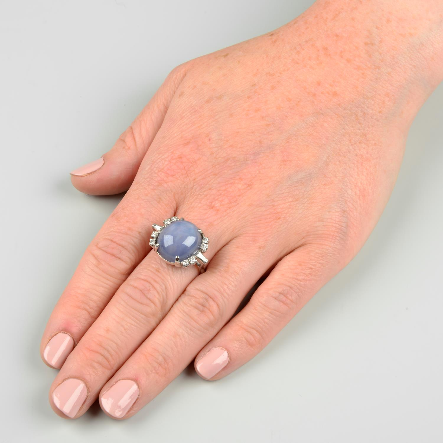 A star sapphire and diamond ring. - Image 3 of 6