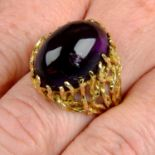 A 1970s 9ct gold amethyst cabochon textured abstract dress ring.