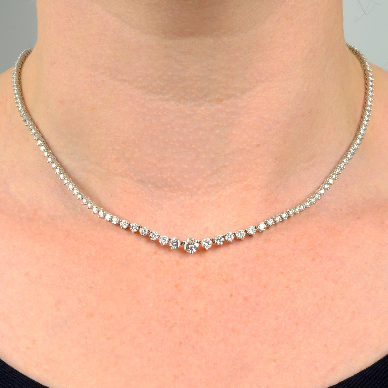 A graduated brilliant-cut diamond line necklace.