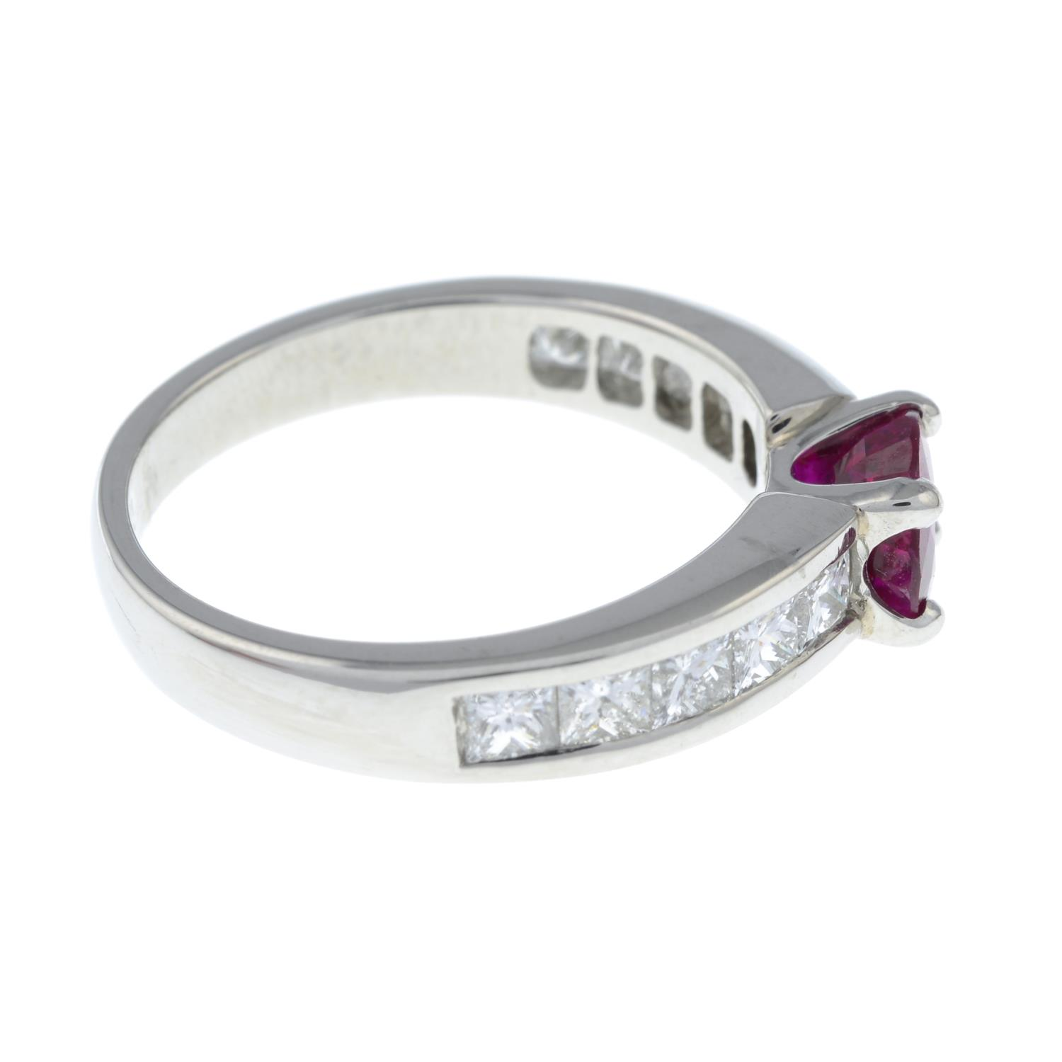 A platinum ruby single-stone ring, with square-shape diamond line shoulders. - Image 6 of 6