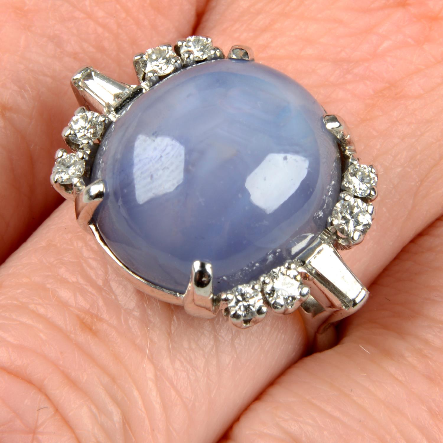 A star sapphire and diamond ring.