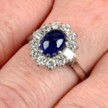 An 18ct gold sapphire cabochon and vari-cut diamond ring.Sapphire calculated weight 1.89cts,