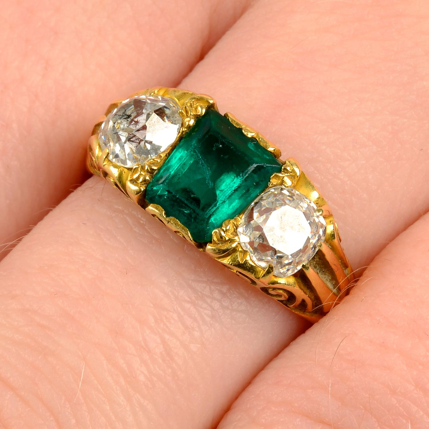 A late Victorian 18ct gold Colombian emerald and old-cut diamond three-stone ring.Verbal from GCS,