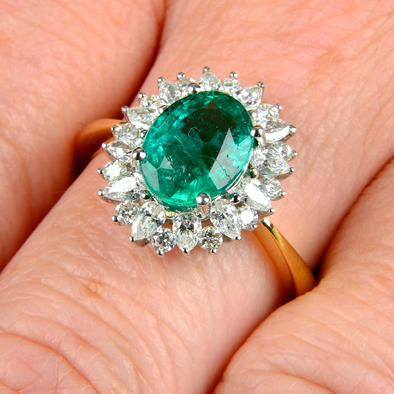 An 18ct gold emerald ring,