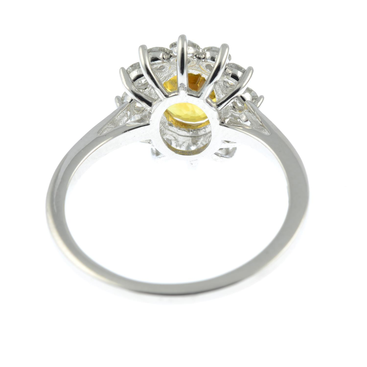A yellow sapphire and brilliant-cut diamond cluster ring.Sapphire calculated weight 1.73cts, - Image 5 of 6