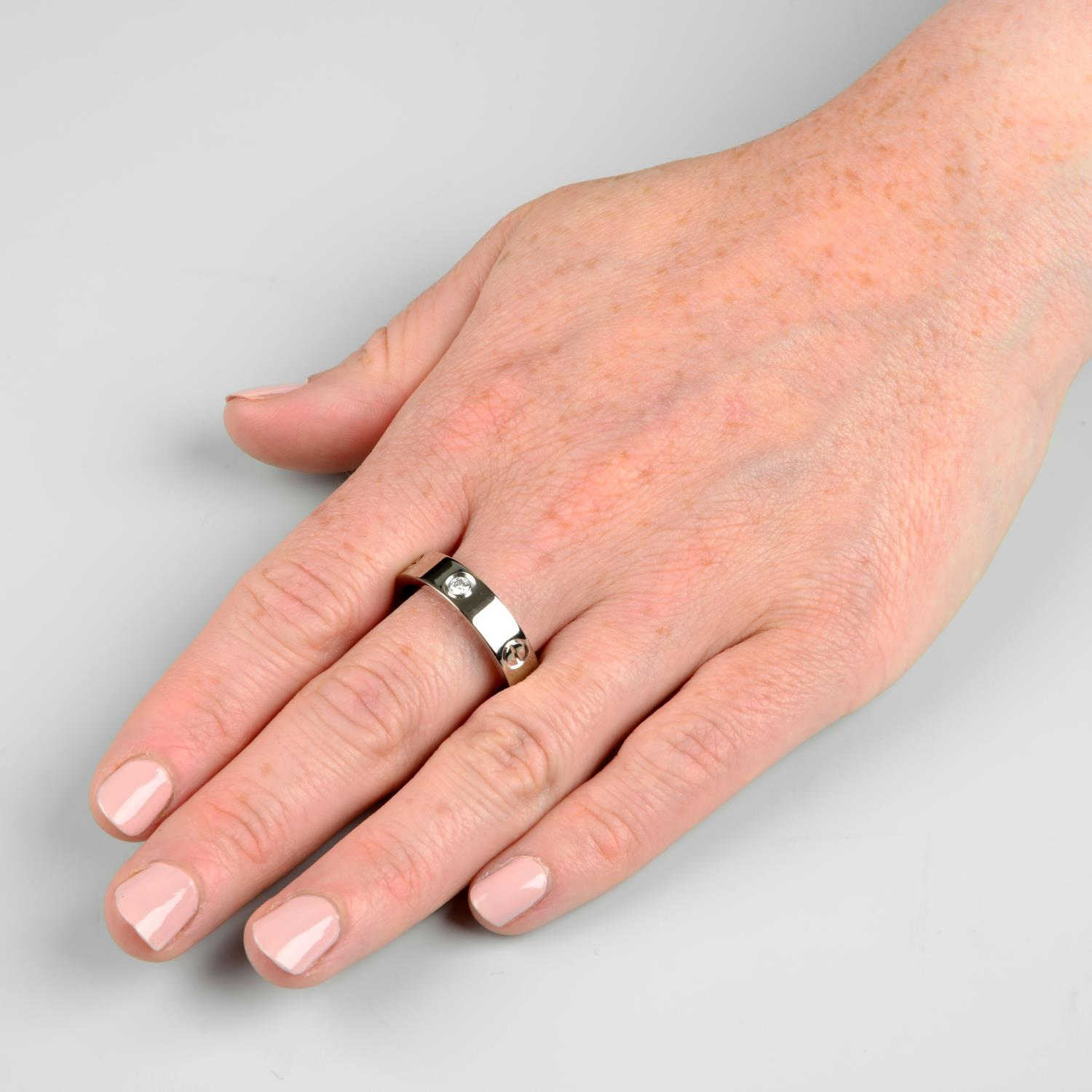 An 18ct gold diamond 'Love' ring, by Cartier.Swiss control marks, stamped Au750. - Image 3 of 5