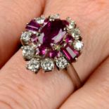 A vari-cut ruby and brilliant-cut diamond dress ring.Principal ruby calculated weight 1.23cts,