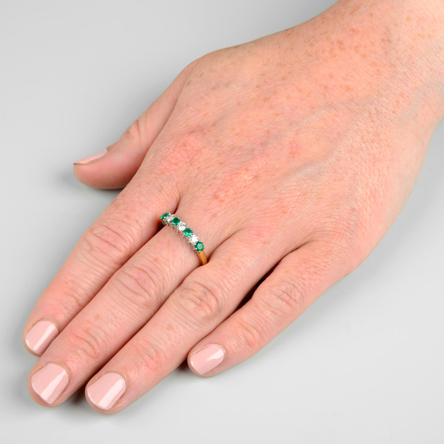 An 18ct gold alternating emerald and brilliant-cut diamond half eternity ring.Estimated total - Image 3 of 5