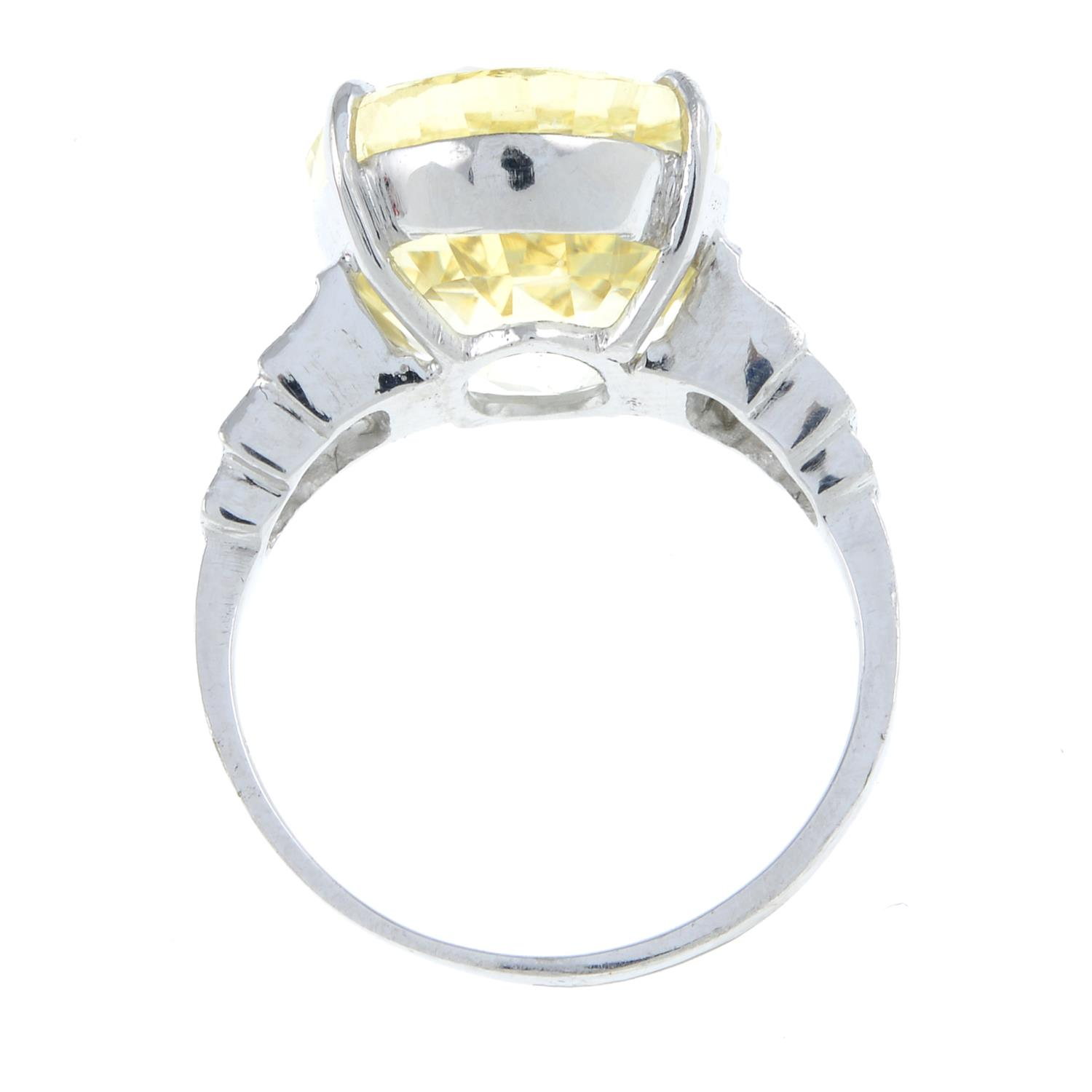 A yellow sapphire and diamond ring.Sapphire weight 15.31cts.Estimated total diamond weight 0.10ct, - Image 6 of 6