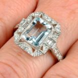 An 18ct gold aquamarine and diamond dress ring.Aquamarine weight 2.07cts.Total diamond weight