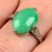An Art Deco platinum and 18ct gold A-type jade cabochon and diamond ring.Verbal from GCS,