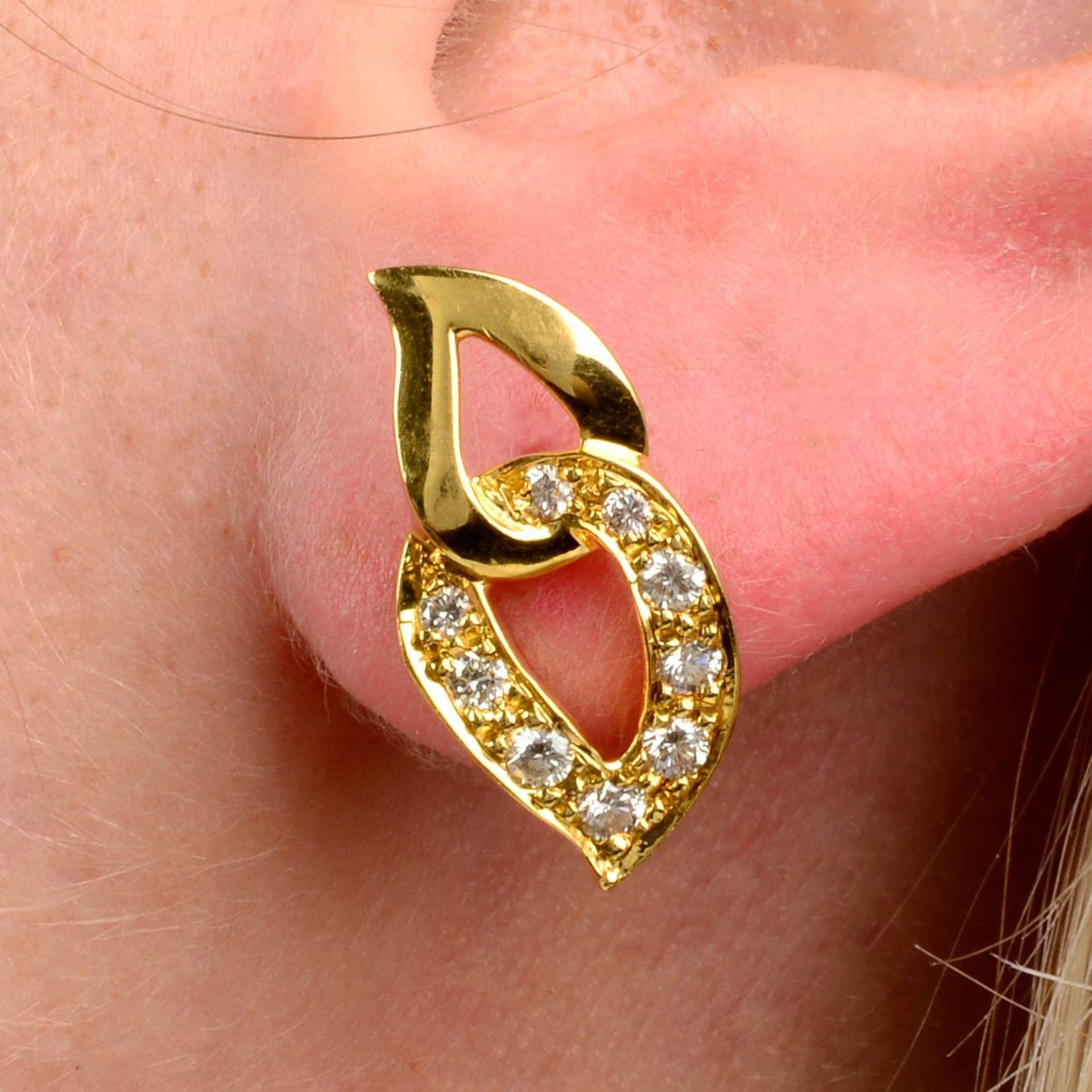 A pair of pavé-set diamond earrings, by Piaget.