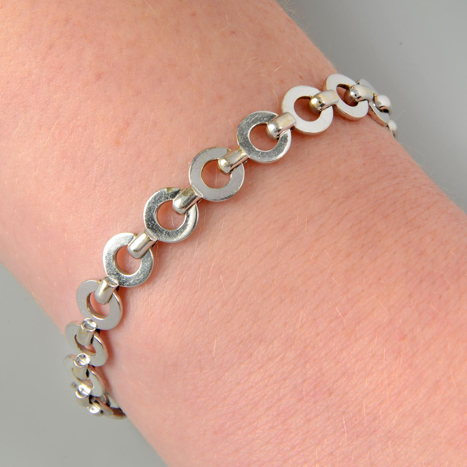 Property of a Lady: a 'Closed C' charm bracelet, by Chanel.French assay marks, stamped 750.