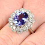 An 18ct gold tanzanite and diamond dress ring.Tanzanite weight 3.71cts.Total diamond weight 0.99ct,