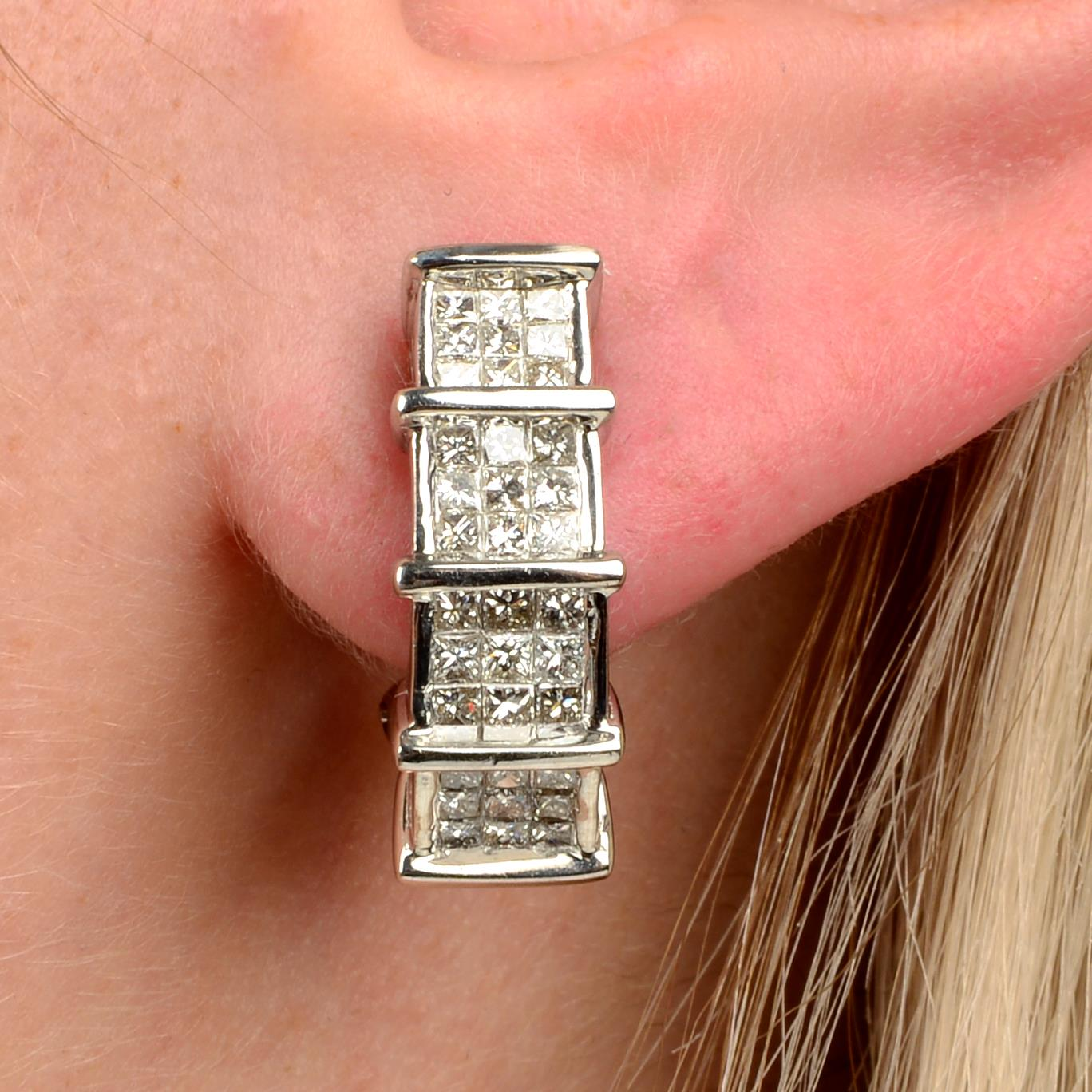 A pair of square-shape diamond half-hoop earrings.Estimated total diamond weight 2cts,