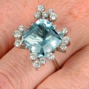 A 1970s 18ct gold aquamarine and diamond cocktail ring.Aquamarine calculated weight 7.20cts,