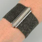 A woven bracelet, with pavé-set diamond clasp, by Carolina Bucci.