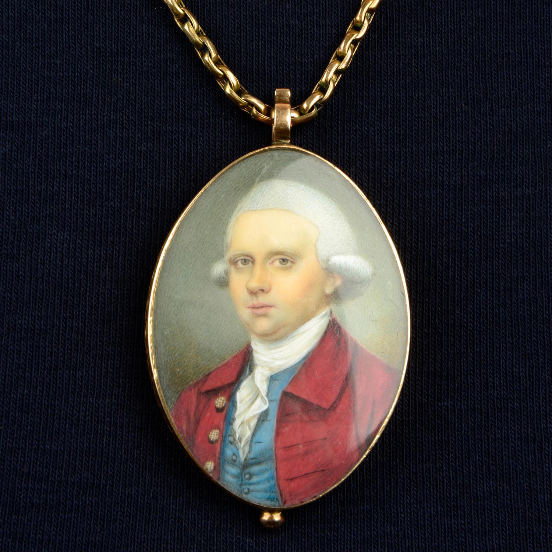 A Georgian portrait miniature locket of a gentleman in a red coat,