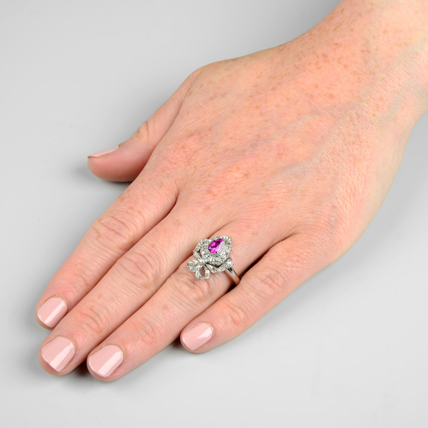 An early 20th century gold ruby and diamond bow ring.Ruby calculated weight 0.74ct, - Image 3 of 5