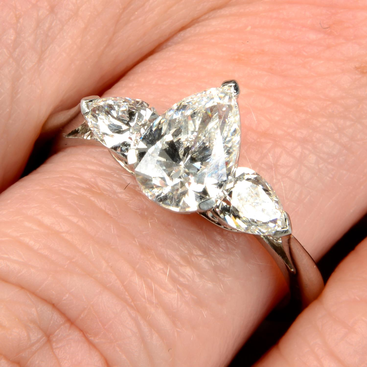 A pear-shape diamond three-stone ring.With report 1146953348,