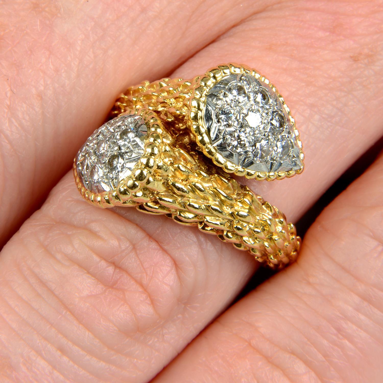 A pavé-set diamond textured crossover dress ring.