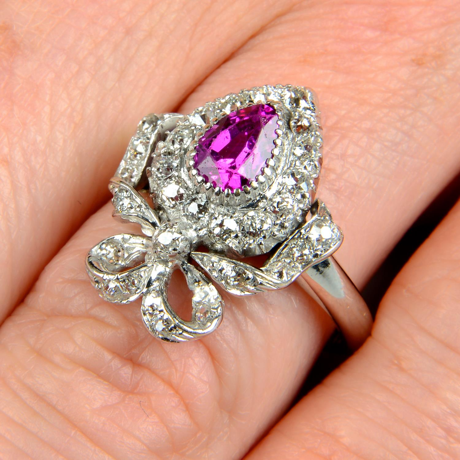 An early 20th century gold ruby and diamond bow ring.Ruby calculated weight 0.74ct,