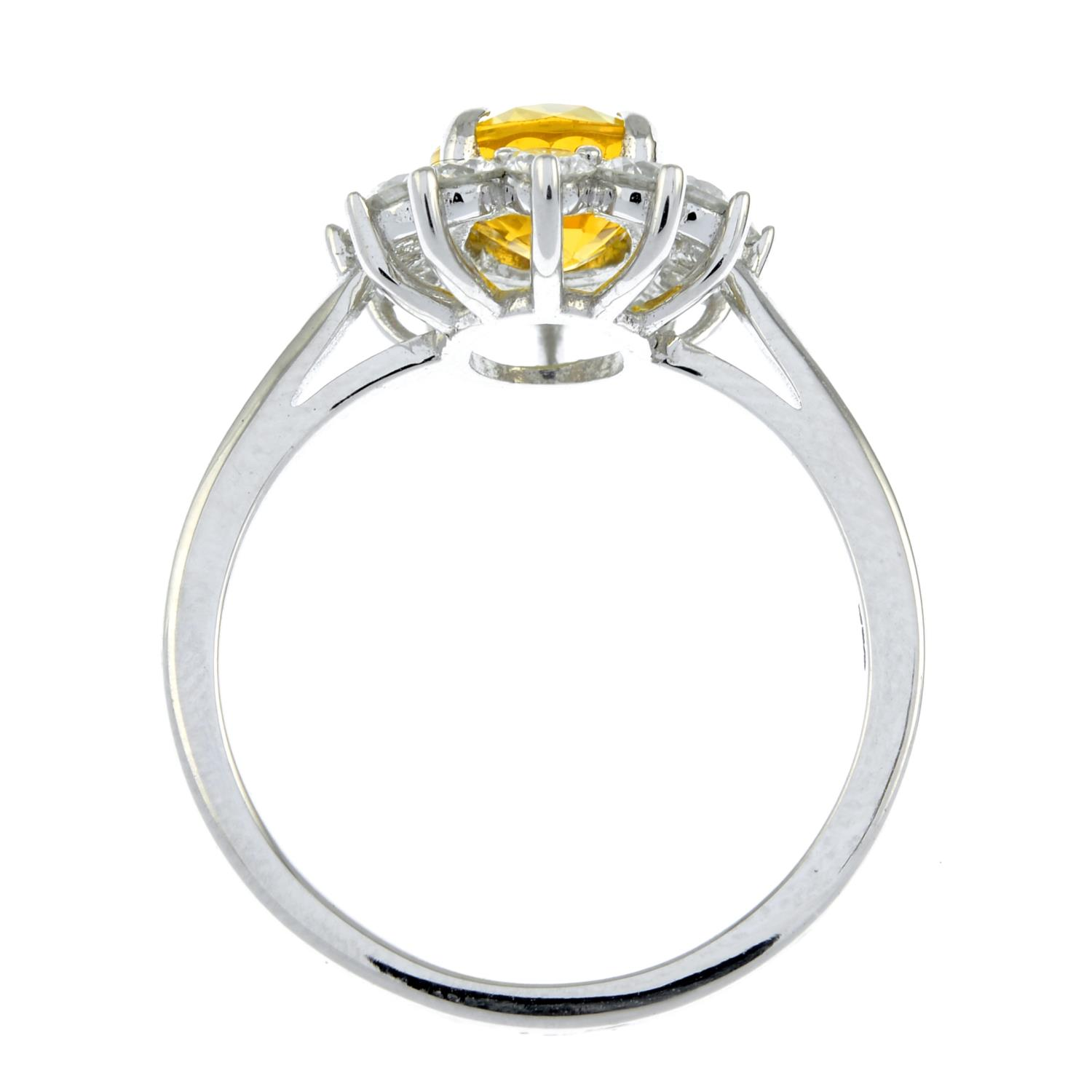 A yellow sapphire and brilliant-cut diamond cluster ring.Sapphire calculated weight 1.73cts, - Image 6 of 6