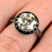 An old-cut diamond dress ring, with onyx surround and shoulders.