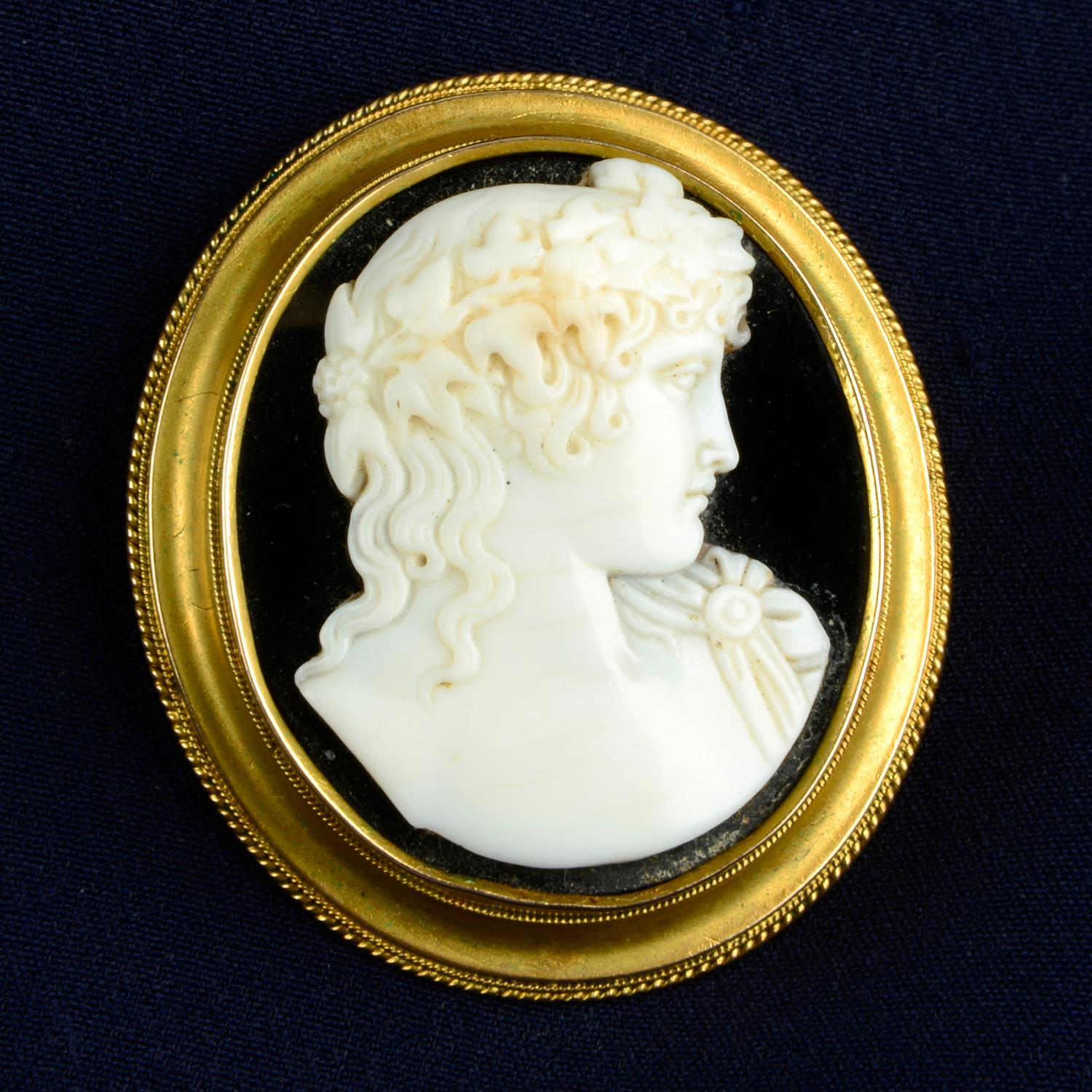 A late Victorian gold onyx and shell cameo brooch, depicting Bacchus.