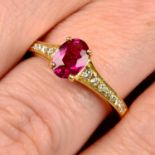 An 18ct gold ruby single-stone ring, with diamond shoulders.