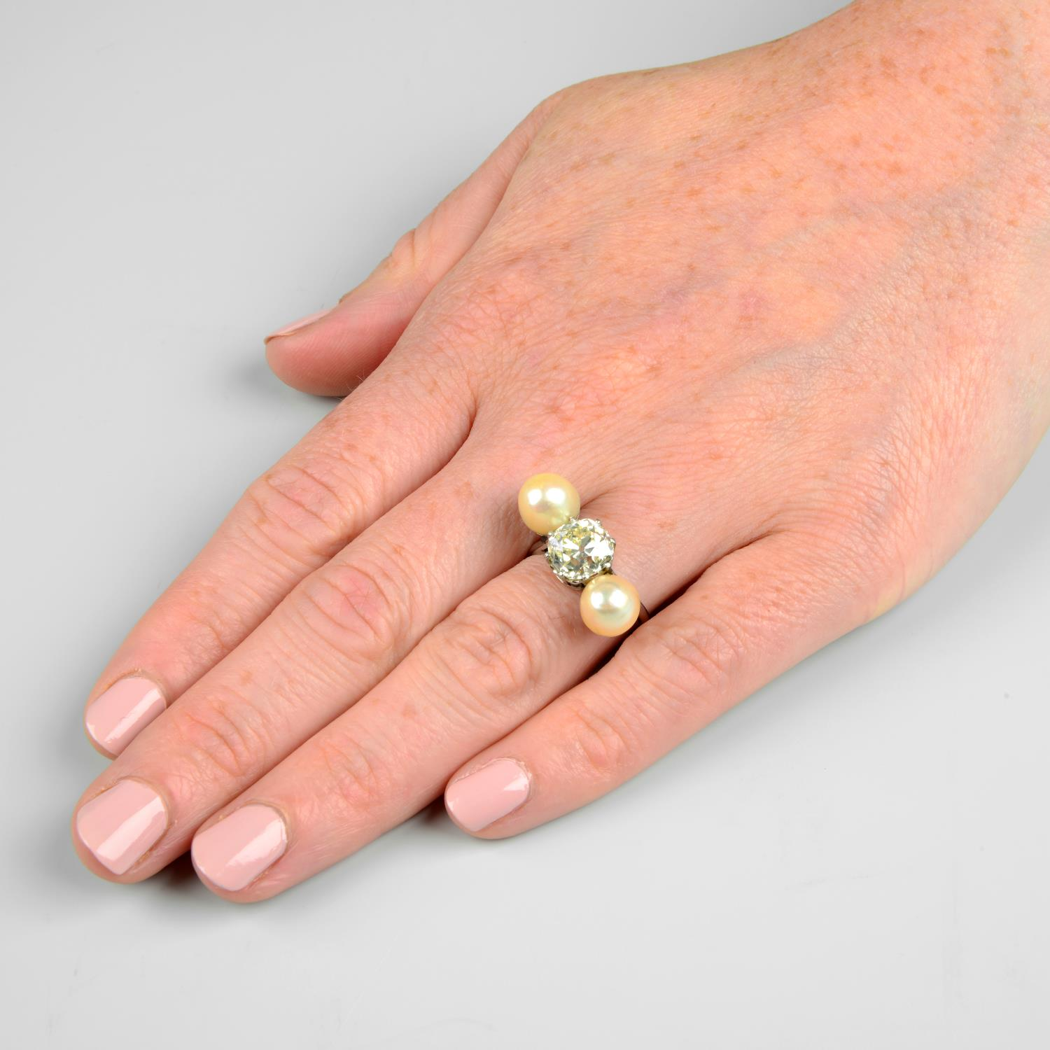 A mid 20th century platinum old-cut diamond and pearl three-stone ring. - Image 3 of 6