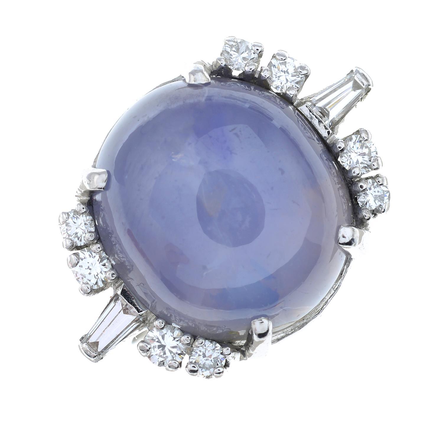 A star sapphire and diamond ring. - Image 2 of 6