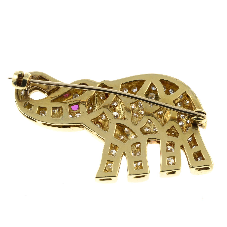A pavé-set diamond elephant brooch, with ruby eye.Total diamond weight 1.70cts.Length 3.9cms. - Image 4 of 4