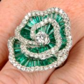 An emerald and diamond floral cocktail ring.