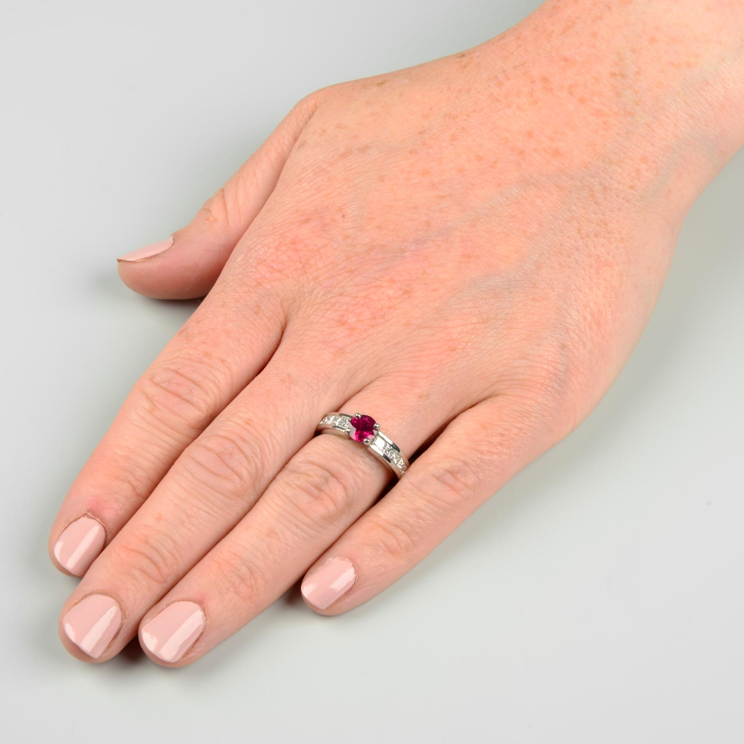 A platinum ruby single-stone ring, with square-shape diamond line shoulders. - Image 3 of 6