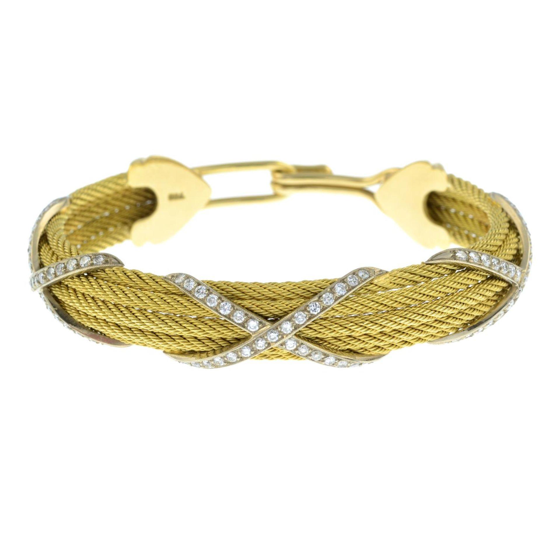 A rope-twist bangle, with pavé-set diamond cross highlights. - Image 2 of 3