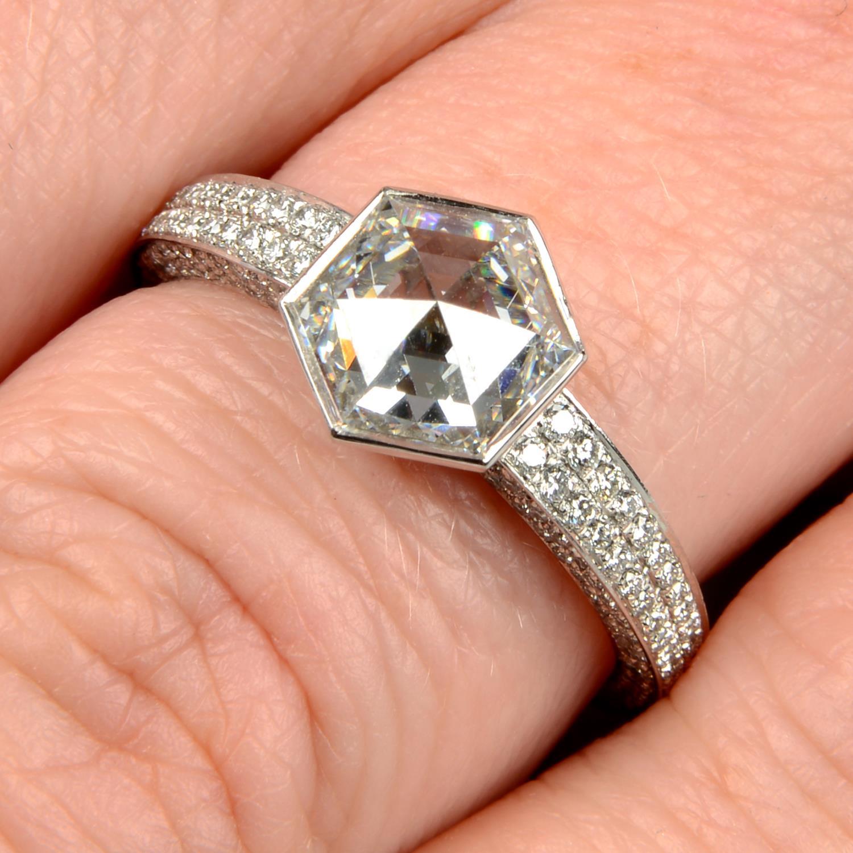 A platinum hexagonal-cut diamond single-stone ring,
