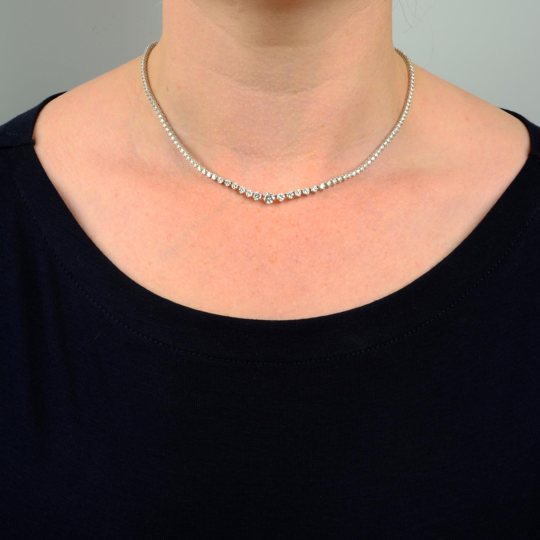 A graduated brilliant-cut diamond line necklace. - Image 3 of 6