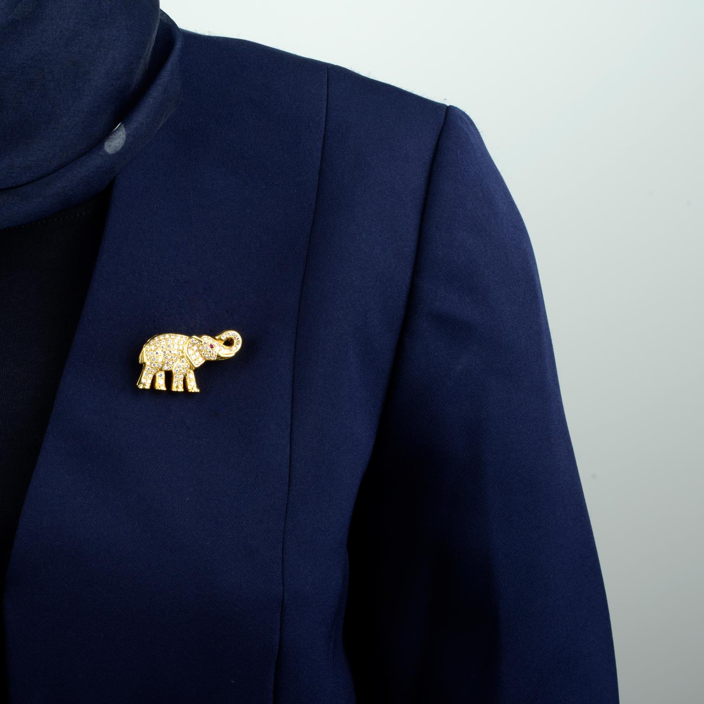 A pavé-set diamond elephant brooch, with ruby eye.Total diamond weight 1.70cts.Length 3.9cms. - Image 3 of 4