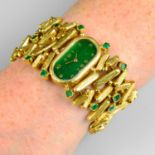 A 1970s 18ct gold emerald cocktail watch, with painted green dial.Maker's mark PG.