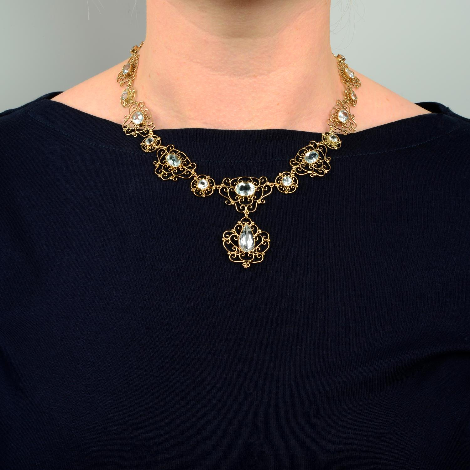 An early 20th century Arts & Crafts gold aquamarine necklace.Length 43.5cms. - Image 3 of 6