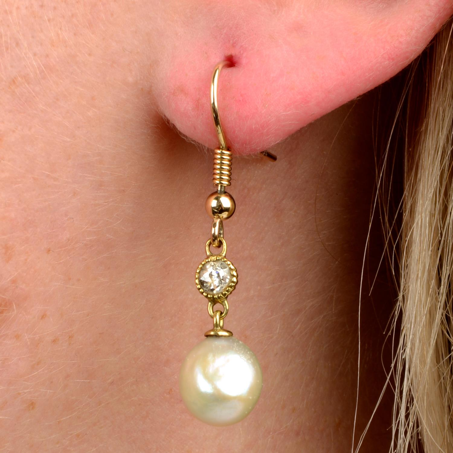 A pair of natural pearl and old-cut diamond drop earrings.