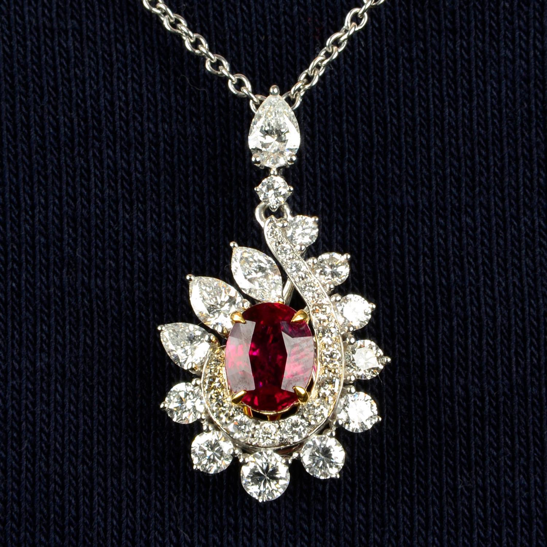 A 'Pigeon's Blood' Burmese ruby and vari-cut diamond cluster pendant,