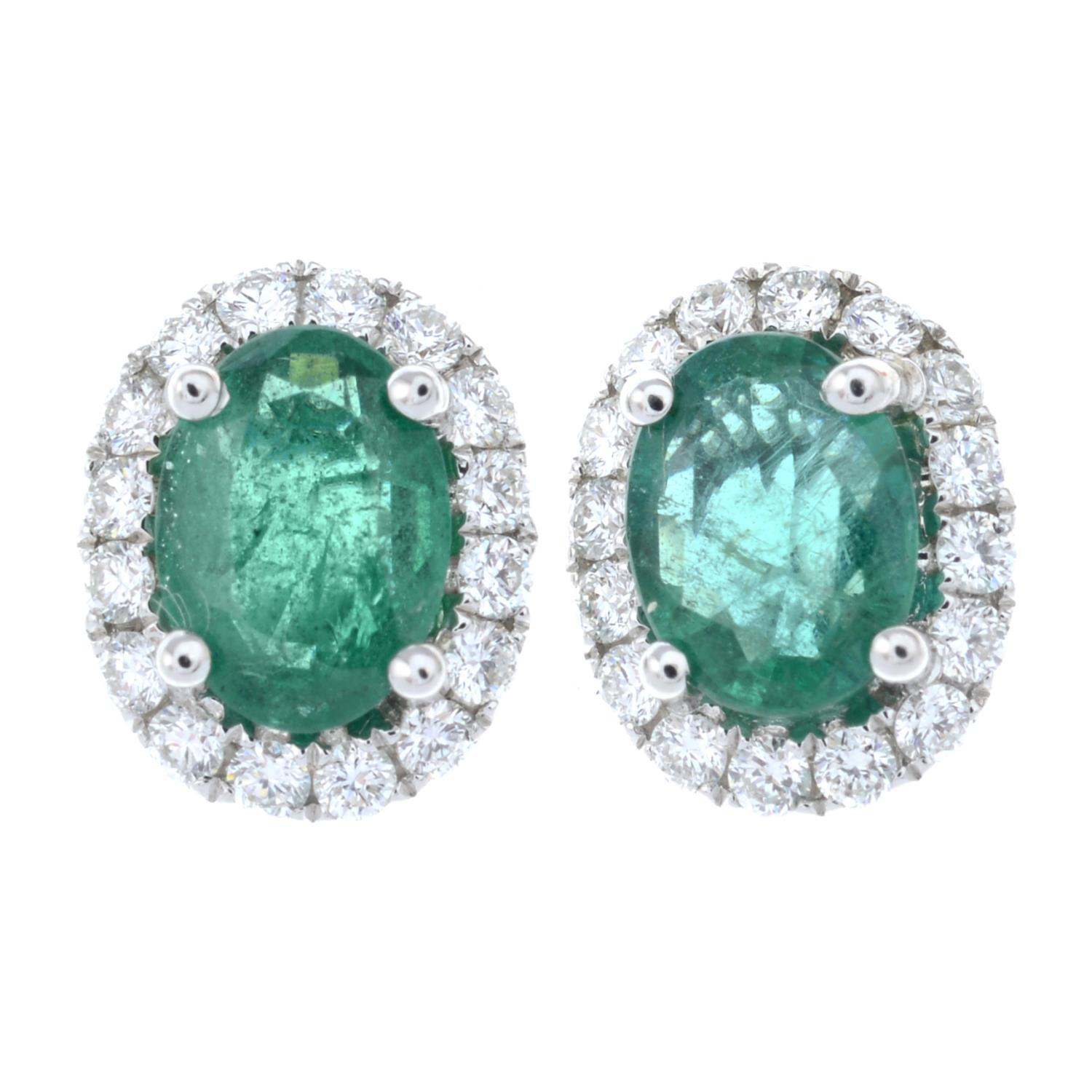 A pair of emerald and diamond cluster earrings.Total emerald weight 1.16cts.Total diamond weight - Image 2 of 3