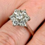 A brilliant-cut diamond floral cluster ring.Estimated total diamond weight 1.40cts,